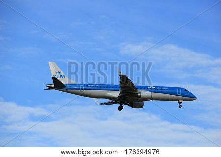 Amsterdam the Netherlands - July 15th 2016: PH-EZM KLM Cityhopper Embraer ERJ-190STD approaching Polderbaan runway at Schiphol Amsterdam Airport arriving from Bristol United Kingdom
