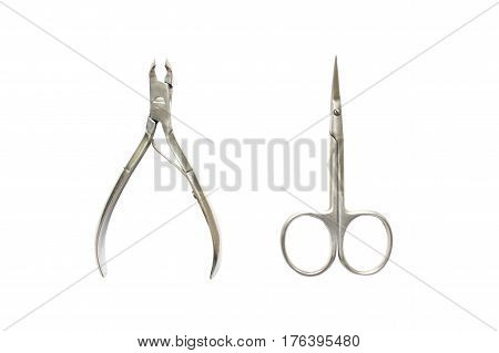 Forceps and scissors for manicure isolated on white background