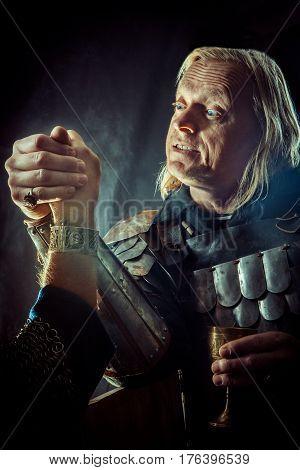 Powerful Knight Has A Hard Arm Wrestling Match