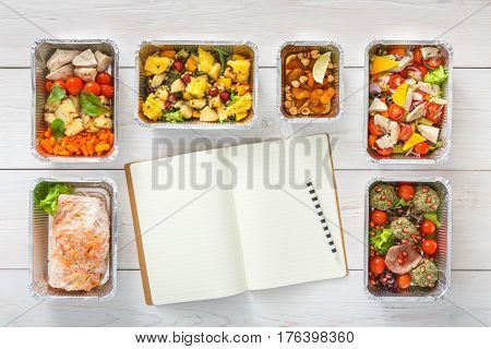 Diet plan mockup with healthy food delivery. Natural organic fitness nutrition for diet. Daily meals in foil boxes with copy space at white wood. Top view, flat lay