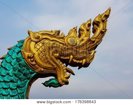 Statue Of A Large Serpent In Golden Head And Green Body