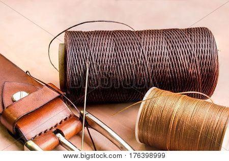 beautiful images of thread needle and belt on leather