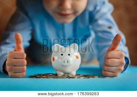 Hands kid and piggy bank or money box