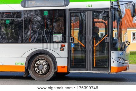 HANNOVER / GERMANY - MARCH 12 2017: regular bus from UESTRA drives on route to the next stop. UESTRA is the operator of public transport in the city of Hanover Germany