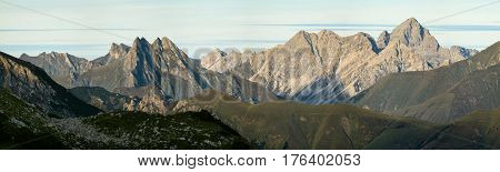 Great clear view from high mountain over other peaks in evening or morning sunlight. Alps, Bavaria, Tirol, Allgau.