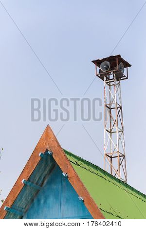 Old Loudspeakers Broadcast Tower With A Clear Sky Background.