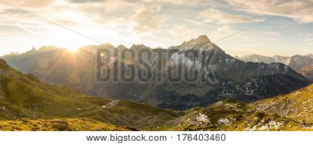 Great sunrise in the mountains.Backlight with nice colorful lens flares and sunbeams. Alps, Bavaria, Tirol, Austria.