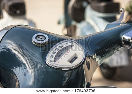 Detail of the handlebar and speedometer of a famous two-wheeled vehicle Italian: La Vespa. A piece of history of Italian vehicles.