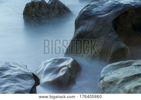 Smooth Rocks and hazy waters (long exposure)