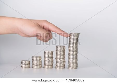 Finger Pushing A Pile Of Coins, Column Of Coins Falls , Business Crisis Concept.