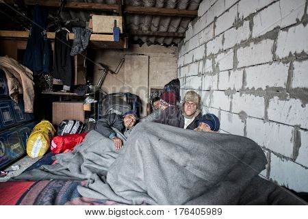 BELGRADE-INFORMAL REFUGE CAMP-JAN 2017--Afghan Refugees sleep on filthy mattresses under blankets in freezing conditions on January 2, 2017 in Belgrade, Serbia