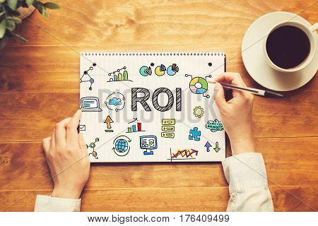 Roi Text With A Person Holding A Pen