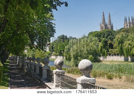 Burgos (Castilla y Leon Spain): cityscape with bicyle path along the river adnd the cathedral