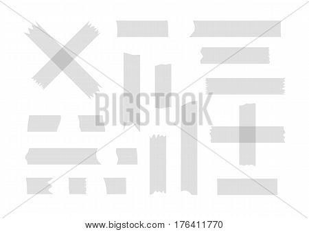 Fragments of gray adhesive tape. Set of twenty torn pieces isolated on white background. Vector illustration. Transparency.