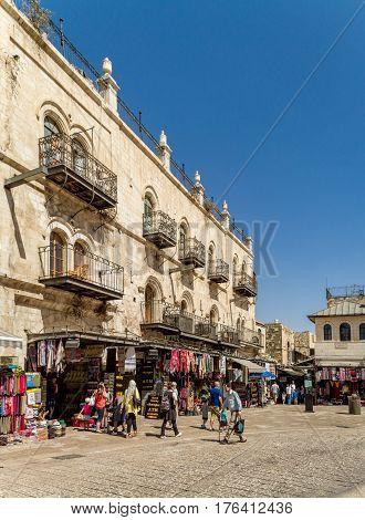 JERUSALEM, ISRAEL - OCTOBER 3: The Old City of Jerusalem near the Jaffa Gate, street market, people walk in Jerusalem, Israel on October 3, 2016