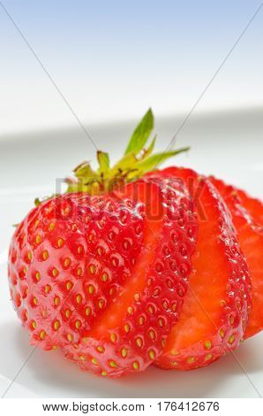 Strawberry slices cut on a white background