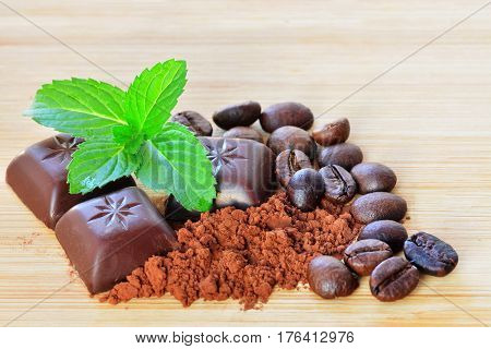 Dark chocolate candies with mint fondant filling and coffee flavored