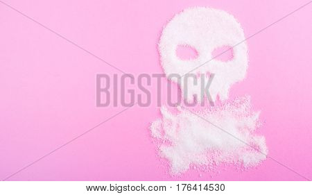 The skull made of sugar. Sugar kills. Pink background