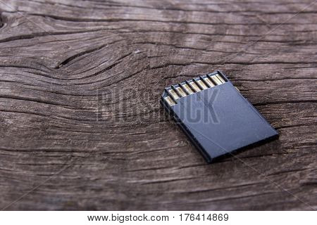 sd card on an old wooden table, close-up