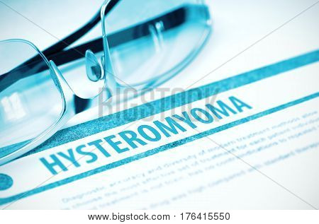 Hysteromyoma - Medical Concept with Blurred Text and Eyeglasses on Blue Background. Selective Focus. 3D Rendering.