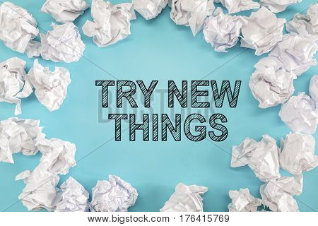 Try New Things Text With Crumpled Paper Balls