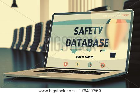 Modern Meeting Room with Laptop Showing Landing Page with Text Safety Database. Closeup View. Toned Image with Selective Focus. 3D Rendering.