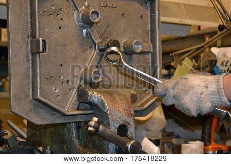 Photo of Professional mechanic working in repair service.