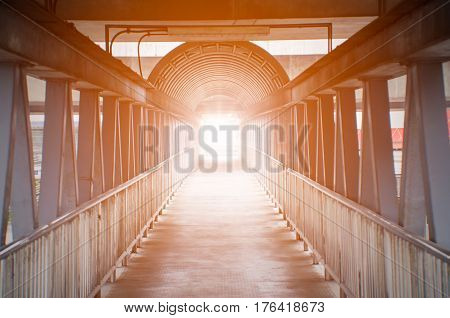 Orange light on pedestrian overpass concept for light discovery.
