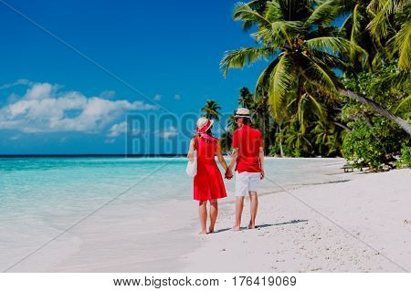 happy loving couple walking on tropical beach vacation
