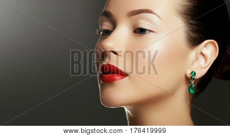 Portrait Of Luxury Woman With Jewelry. Model In Expensive Earrings