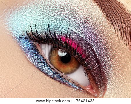 Beauty, Cosmetics And Makeup. Magic Eyes Look With Bright Makeup. Macro Shot Of Beautiful Woman's Fa