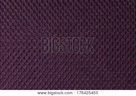 Purple fishnet cloth material as a texture background. Nylon texture pattern or nylon background for design with copy space for text or image.