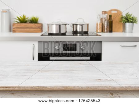 Bleached wooden texture table on defocused kitchen stove interior background