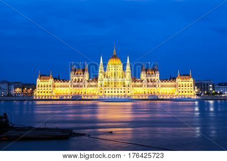 Parliament building in Budapest, Hungary. Building facade with reflection in water. Beautiful picture at sunset