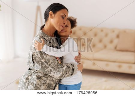 Together again. Loving emotional beautiful mom meeting her daughter after long month apart while she serving in the military and working for her future