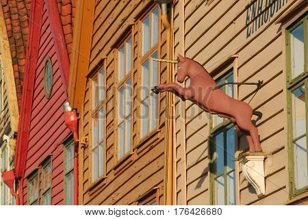 Unicorn sign on a Hanseatic house at Bryggen the historic district in Bergen Norway