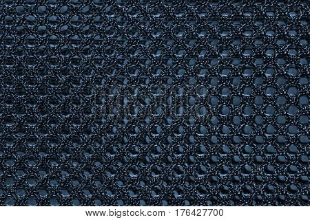 Blue fishnet cloth material as a texture background. Nylon texture pattern or nylon background for design with copy space for text or image.