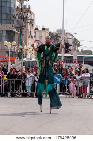 Juggler With Hoops Goes On Stilts And Shows His Art