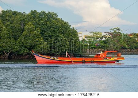 Labuan,Malaysia-Mac 15,2017:Local fishing boat in the evening at Labuan island,Malaysia.Aquaculture industry in Labuan has become one of engine of growth that contributes to the economy of Labuan.