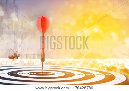 Mutil explosure red dart arrow on center of dartboard on bokeh blur background metaphor to target success winner concept