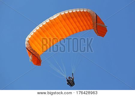Paraglider descending his wing under big ears