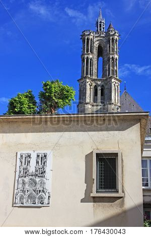 Laon Abbey tower and mural on a house