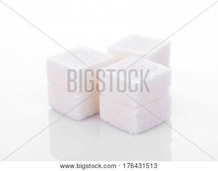CloseUp sugar cube on white background. food