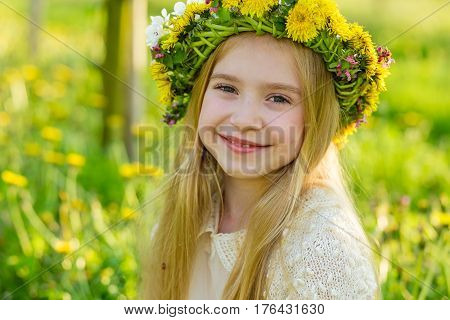 A Beautiful Little Girl Runs Through A Flowering Garden In The Spring