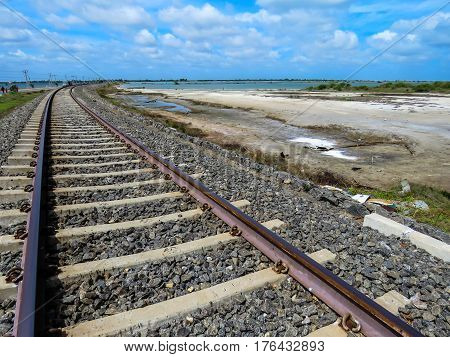 Gravel Train Road Railway Track with Blue Sky and Clouds