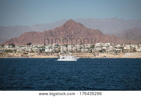 View at the shore of Sham El-Sheikh white yacht and Sinai