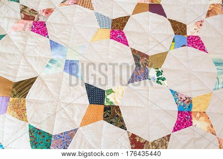 Part of color patchwork quilt as background. Handmade. Colorful Scrappy blanket.