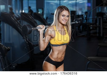 Sexy Young Athletics Girl Posing With Barbell On Her Shoulders. Fitness  Woman In Red Sport Clothing