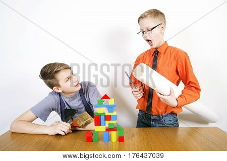Boys play in construction of the house. Builder and architect. Construction concept.