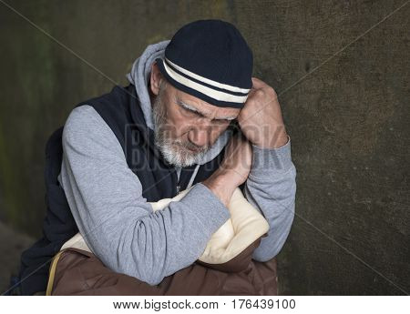 Mature homeless man looking upset and distressed